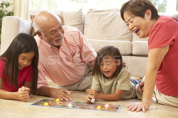 Nagyszülők unokák játszik társasjáték otthon lány Stock fotó © monkey_business