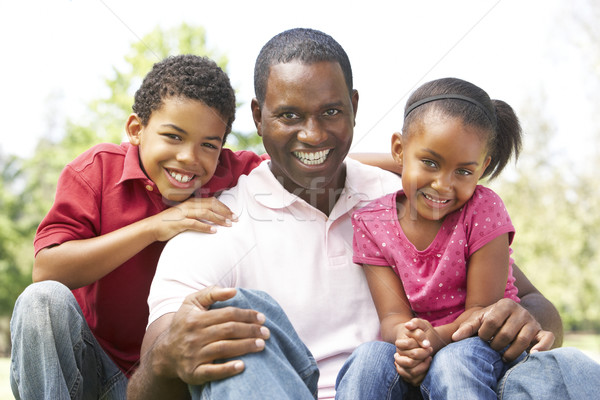 Stock photo: Father With Children In Park