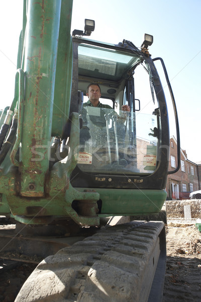 Construction Worker Using Digger Stock photo © monkey_business