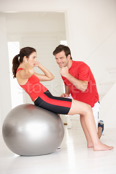 Woman with personal trainer in home gym Stock photo © monkey_business