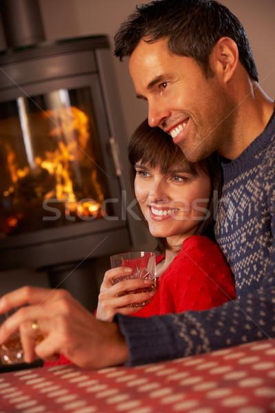 Stockfoto: Paar · vergadering · sofa · kijken · tv