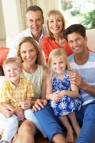 Többgenerációs család megnyugtató kanapé otthon család nők Stock fotó © monkey_business