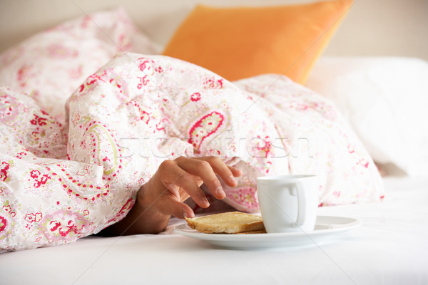 Man's Hand Reaching From Under Duvet For Breakfast Stock photo © monkey_business