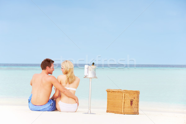 Couple On Beach With Luxury Champagne Picnic Stock photo © monkey_business