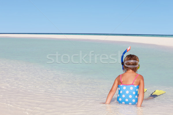 Girl Sitting On Beach Wearing Snorkel And Flippers Stock photo © monkey_business