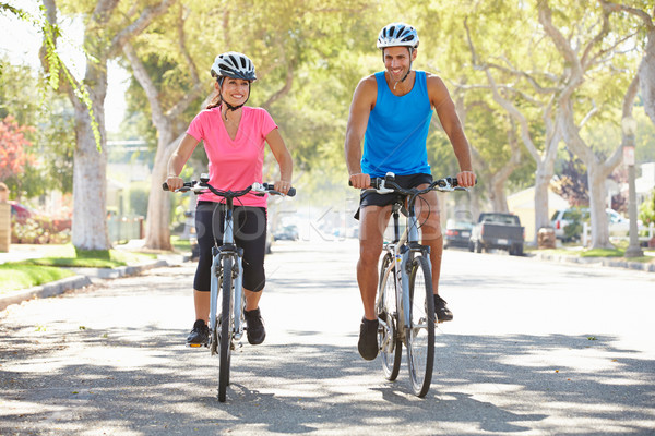 Couple Cycling On Suburban Street Stock photo © monkey_business