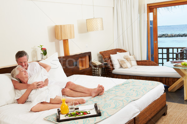 Senior Couple Relaxing In Hotel Room Wearing Robes Stock photo © monkey_business