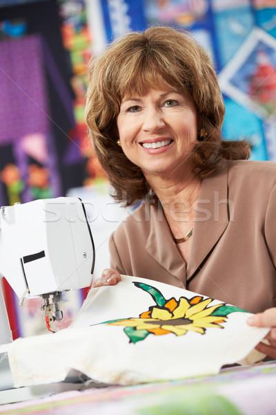 Portrait Of Woman Using Electric Sewing Machine Stock photo © monkey_business
