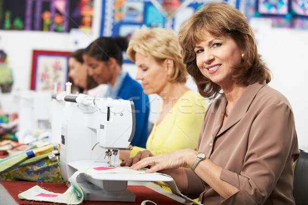 Group Of Women Using Electric Sewing Machines In class Stock photo © monkey_business