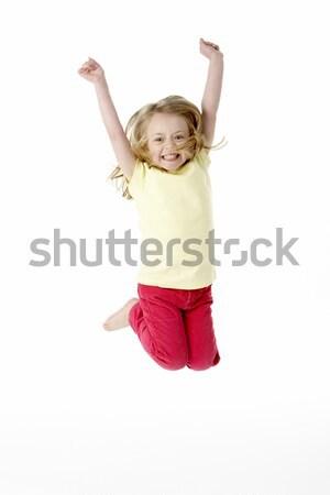 Giovane ragazza aria ragazza felice jumping Foto d'archivio © monkey_business
