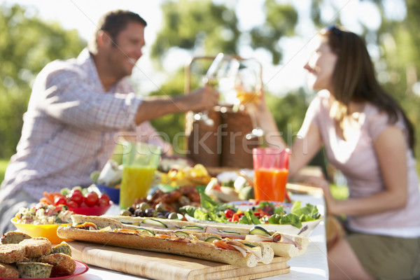 Couple Dining Al Fresco, Toasting Each Other Stock photo © monkey_business