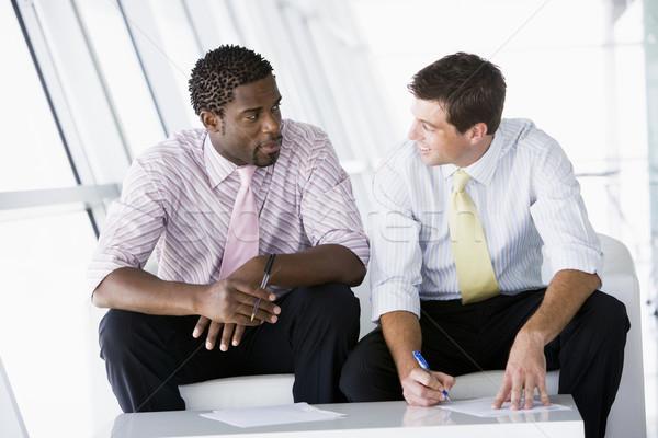 Kettő üzletemberek ül iroda lobbi beszél Stock fotó © monkey_business