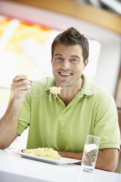 Férfi eszik ebéd kávézó boldog szín Stock fotó © monkey_business