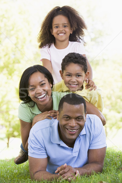 Stock photo: Family lying outdoors smiling
