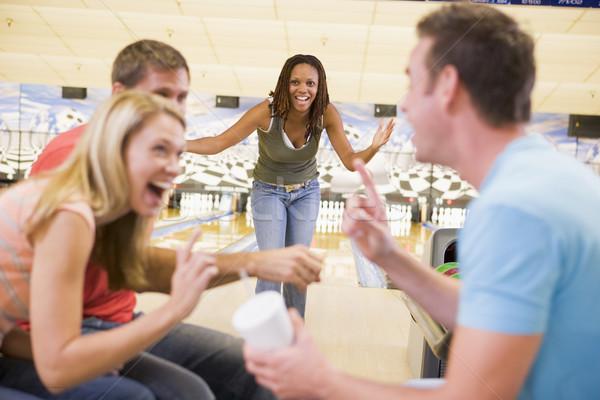 Quattro giovani adulti ridere bowling sport Foto d'archivio © monkey_business