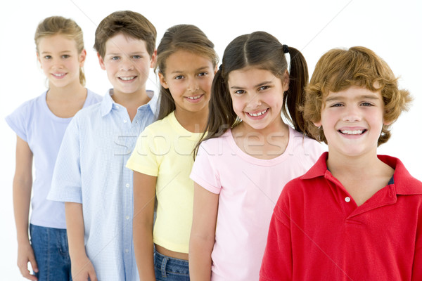 Row of five young friends smiling Stock photo © monkey_business