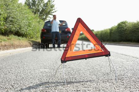 Female Driver Broken Down On Country Road With Hazard Warning Si Stock photo © monkey_business