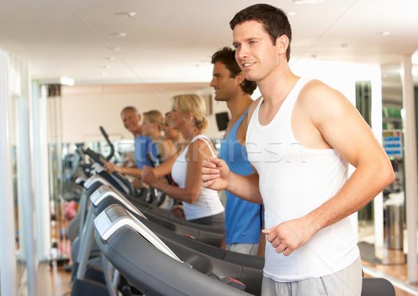 Stock photo: Man On Running Machine In Gym