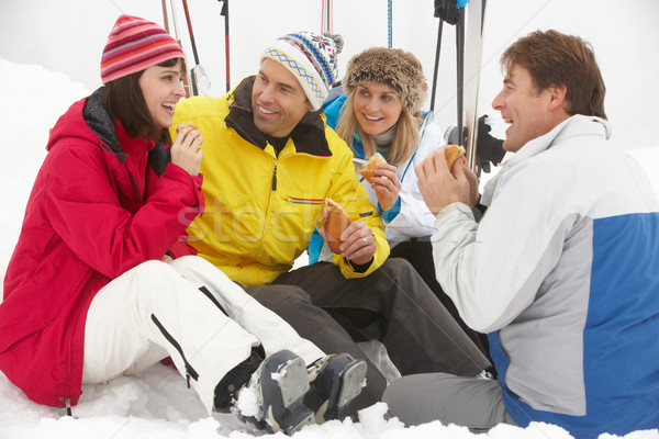 Stock photo: Group Of Middle Aged Friends Eating Sandwich On Ski Holiday In M