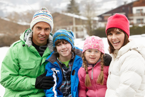 Portrait Of Family Wearing Winter Clothes In Snowy Landscape Stock photo © monkey_business