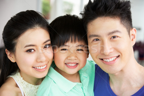 Head And Shoulders Portrait Of Chinese Family Together At Home Stock photo © monkey_business