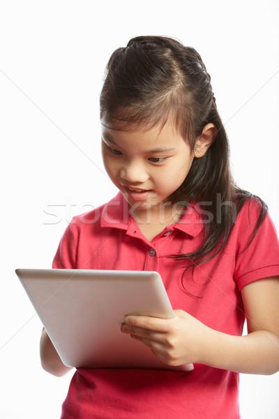 Chińczyk dziewczyna cyfrowe tabletka szczęśliwy Zdjęcia stock © monkey_business