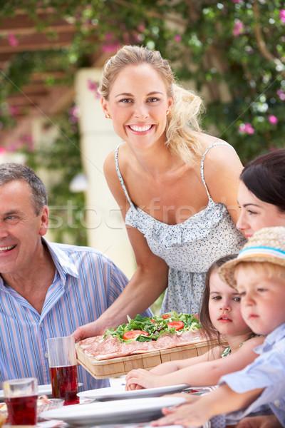Nő adag többgenerációs család étel férfi nők Stock fotó © monkey_business