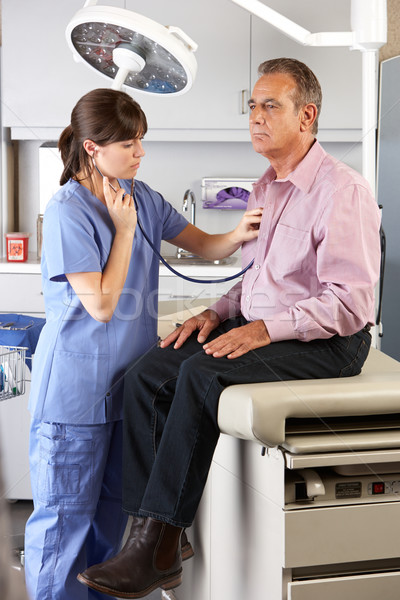Male Patient Visiting Doctor's Office Stock photo © monkey_business