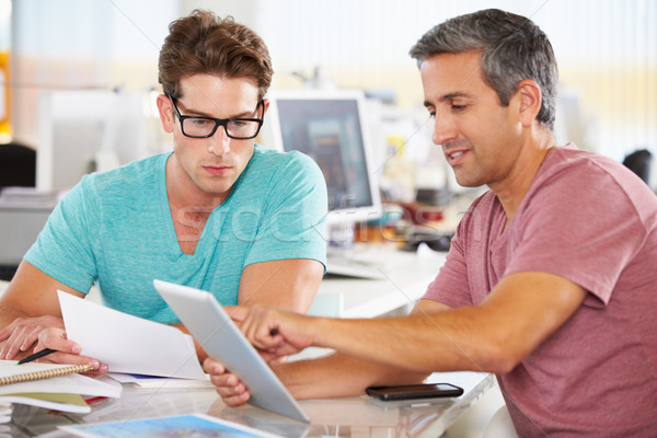 Two Men Using Tablet Computer In Creative Office Stock photo © monkey_business