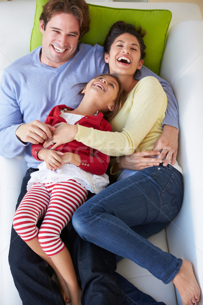 Stock photo: Overhead View Of Family Relaxing On Sofa