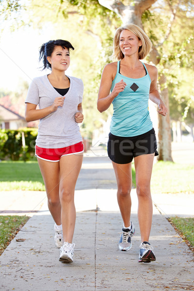 Two Female Runners Exercising On Suburban Street Stock photo © monkey_business