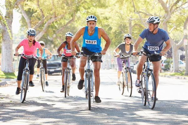 Grupo ciclistas suburbano calle mujer carretera Foto stock © monkey_business