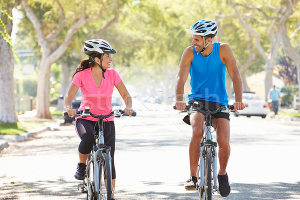Stock photo: Couple Cycling On Suburban Street