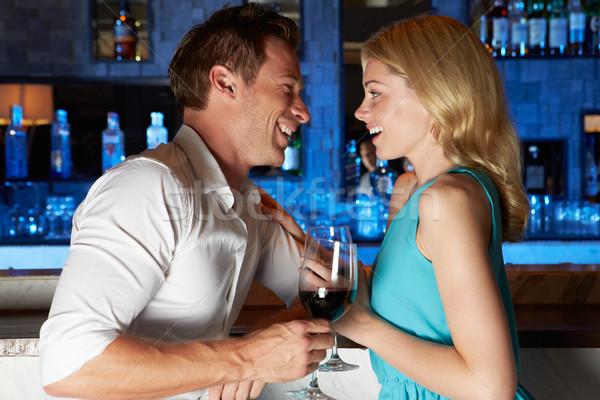 Pár élvezi ital bár üveg hotel Stock fotó © monkey_business