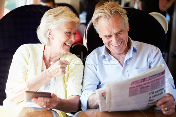 Casal de idosos relaxante trem jornada mulheres feliz Foto stock © monkey_business