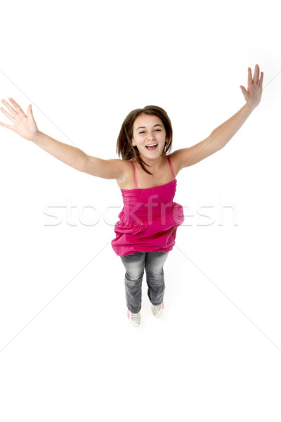 Young Girl Leaping In Studio Stock photo © monkey_business