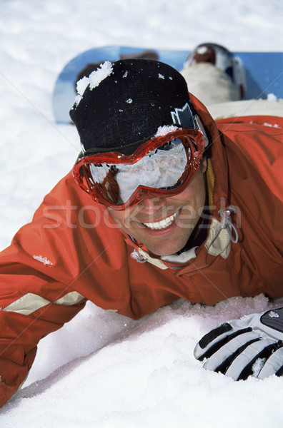 Young snowboarder lying in the snow Stock photo © monkey_business