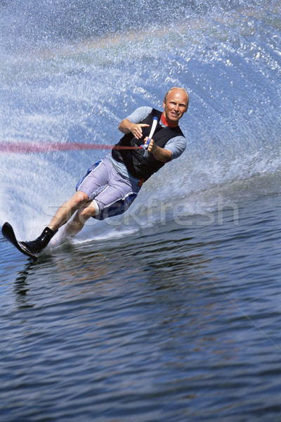 A young man water skiing Stock photo © monkey_business