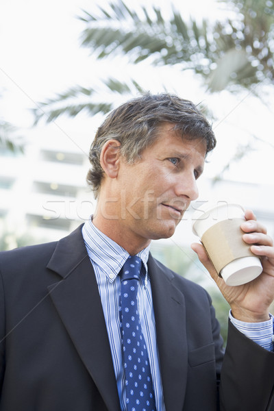 Businessman outdoors drinking coffee Stock photo © monkey_business