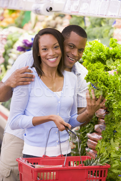 Couple shopping in produce section Stock photo © monkey_business