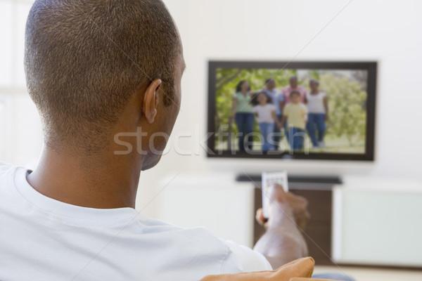 Férfi nappali tv nézés technológia portré kanapé Stock fotó © monkey_business