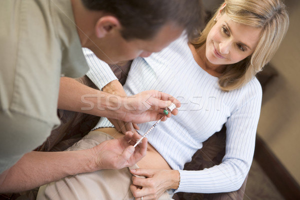 Man helping woman inject drugs to prepare for IVF treatment Stock photo © monkey_business