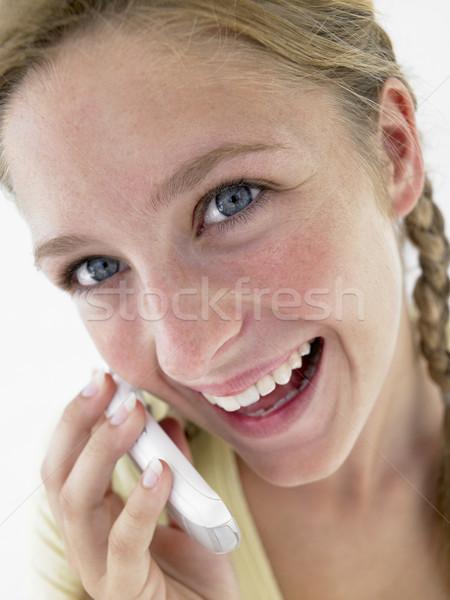Retrato sonriendo hablar teléfono celular nina Foto stock © monkey_business