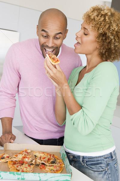 Férj feleség eszik pizza pár mosolyog Stock fotó © monkey_business