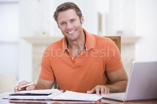 Homem sala de jantar laptop sorridente tabela trabalhando Foto stock © monkey_business