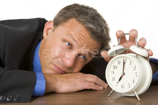 Businessman Leaning On Desk Watching Clock Stock photo © monkey_business