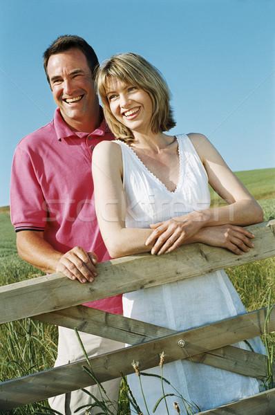 Casal em pé ao ar livre cerca sorridente mulher Foto stock © monkey_business