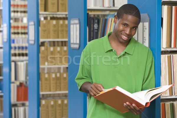 Egyetemi hallgató dolgozik könyvtár tanul könyv oktatás Stock fotó © monkey_business