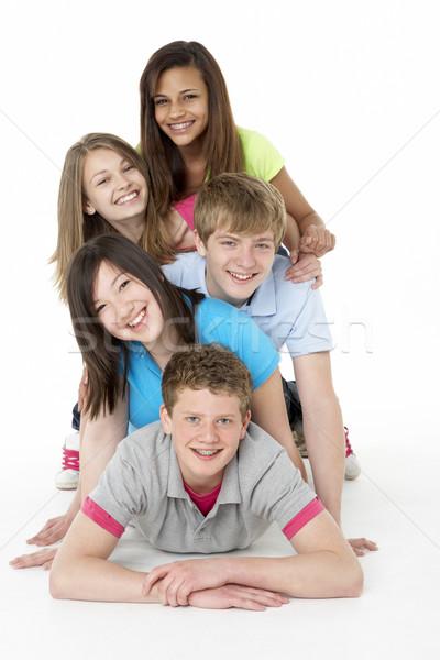 Grupy znajomych studio nastolatek uśmiechnięty Zdjęcia stock © monkey_business