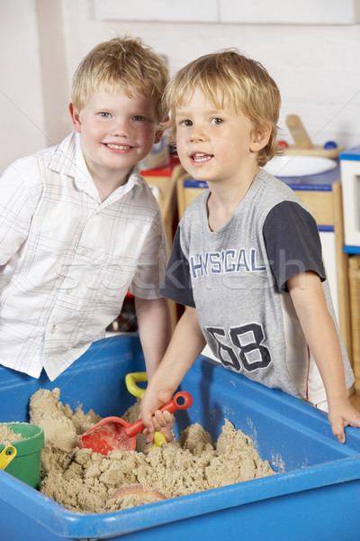 Two Young Boys Playing Together in Sandpit  Stock photo © monkey_business